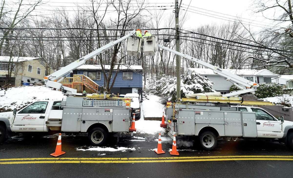 A Frontier Communications crew makes repairs on Marvelwood Drive in New Haven in 2018.