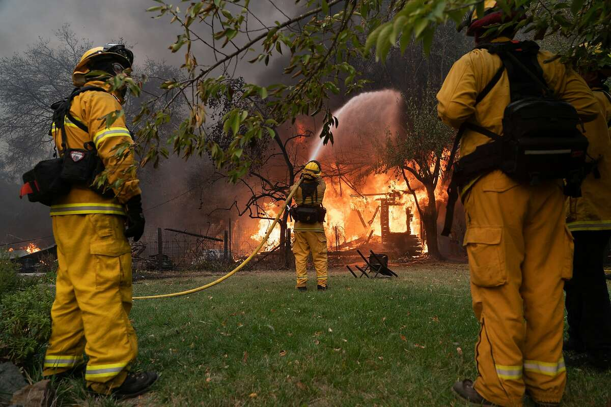 Firefighters contain a fire to a hours on Geyser Road,,Thursday, Oct. 24, 2019, in Geyserville, Calif.