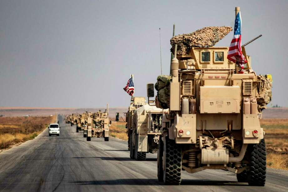 U.S. military vehicles drive on a road in the town of Tal Tamr this month  after pulling out of their base. A reader says President Donald Trump betrayed many more than just the Kurds when he withdrew troops from Syria. Photo: DELIL SOULEIMAN /AFP Via Getty Images / AFP or licensors