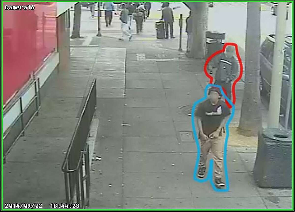 Two suspects, one who is accused of killing Rashawn Williams, 14, are shown in security video, 10 minutes before the killing, near a McDonald's at 24th and Mission Streets, according to the San Francisco Public Defender's Office. The suspect accused of killing Rashawn was outlined in blue. The other person is outlined in red.