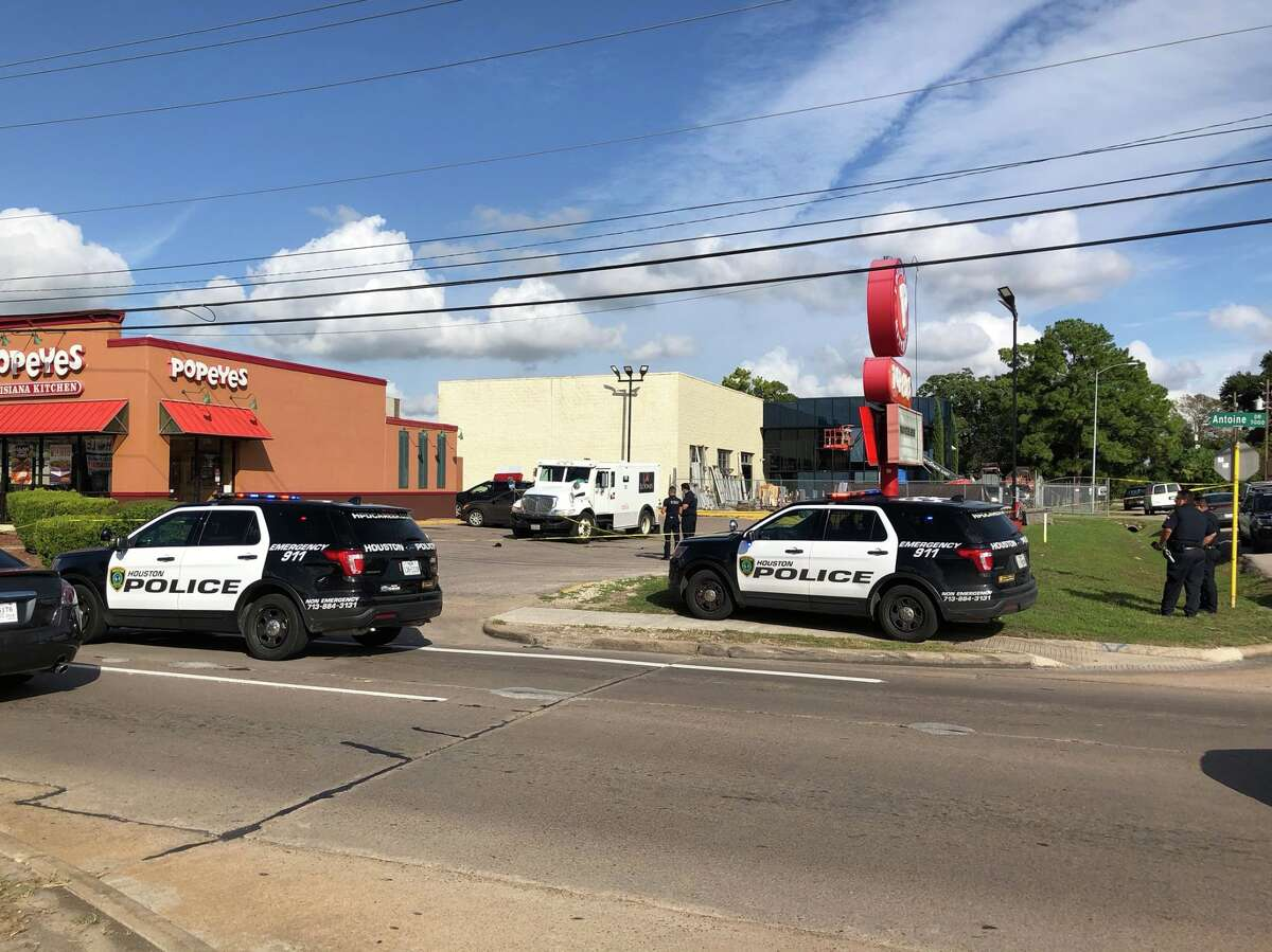 Houston police and federal authorities investigate a armored truck robbery that left a guard dead Thursday, Oct. 24, 2019.