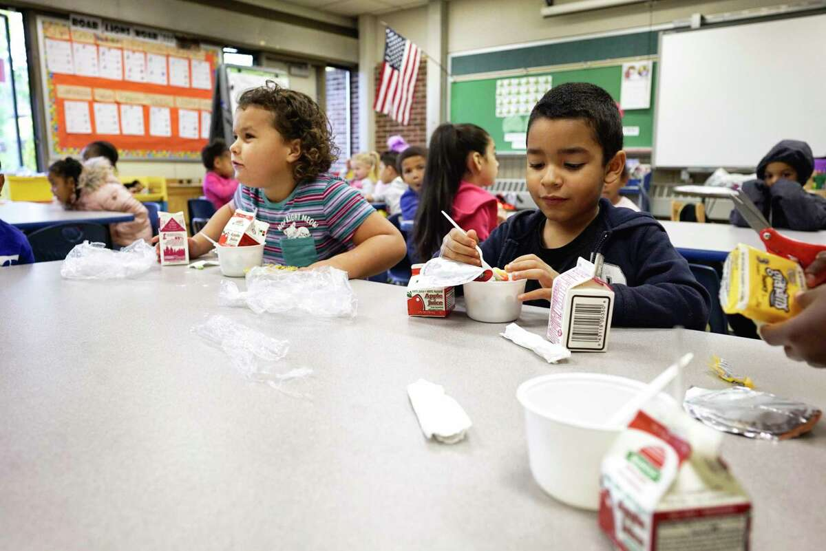 Dr. Martin Luther King Jr. Elementary School students in Scott Heller's kindergarten class eat breakfast on Tuesday, Oct. 22, 2019, in Schenectady, N.Y. All the students at the school get free breakfast in the classroom and free lunch. (Paul Buckowski/Times Union)