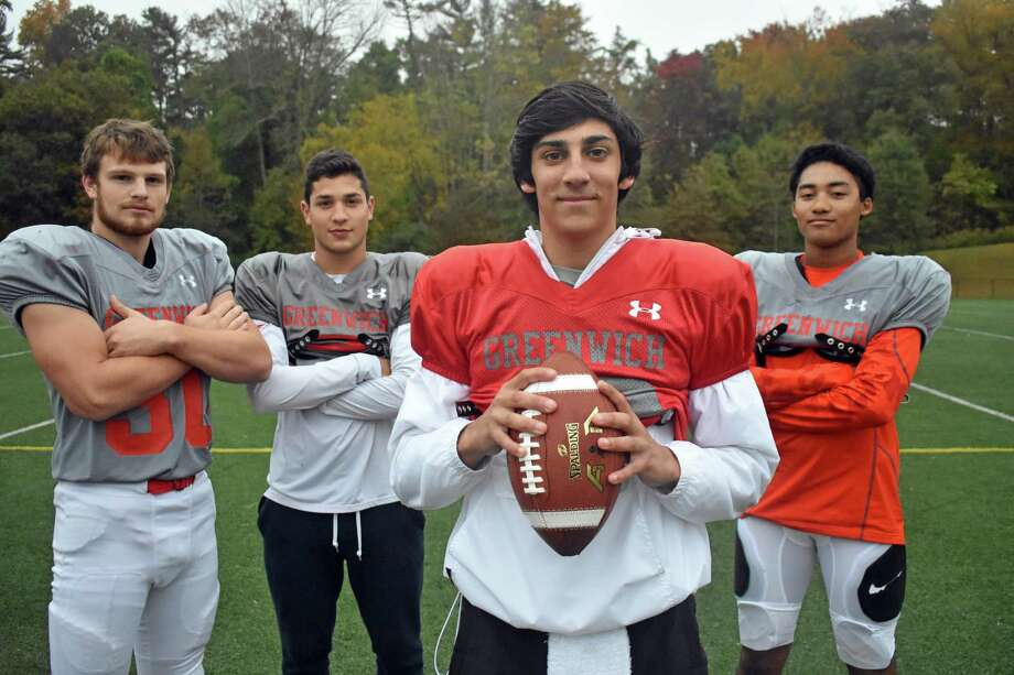 Greenwich's James Rinello, center, has had help from Hunter Clark, Kobe Comizio and AJ Barber this season for the Cardinals. Photo: Pete Paguaga / Hearst Connecticut Media / Connecticut Post