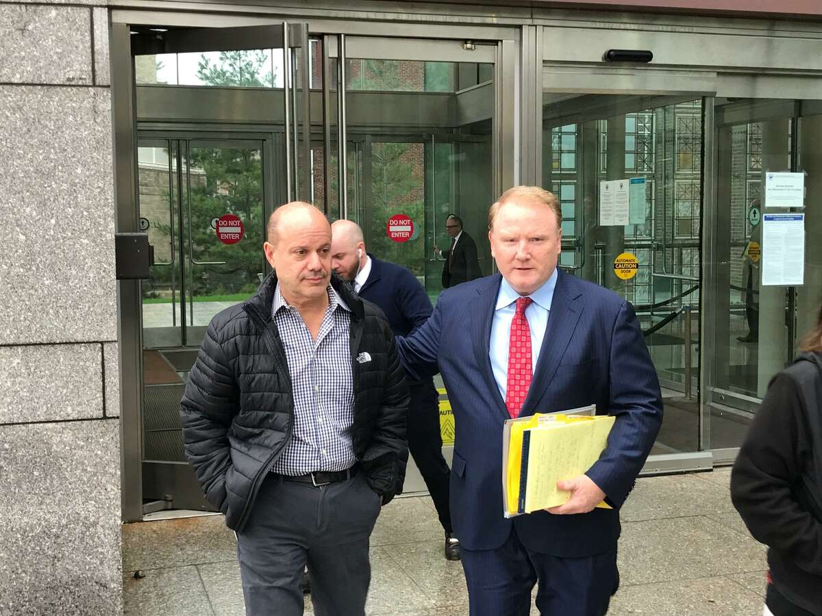 Charles Pia with his criminal defense attorney Stephan Seeger leaving the Stamford courthouse on Thursday, April 18, 2019.