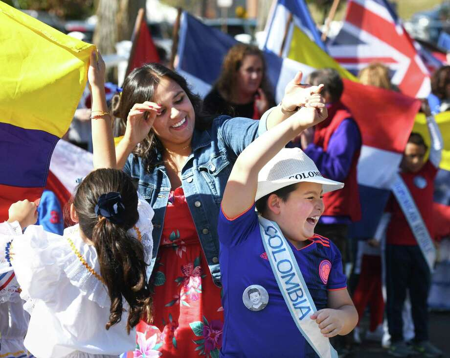 "Third-grade teacher Jenna Mazzilli dances with fourth-grader Ryan Miranda, representing Colombia, at the 29th Annual United Nations Day Celebration ""Parade of Nations"" at Julian Curtiss School in Greenwich, Conn. Thursday, Oct. 24, 2019. Students representing 67 countries and speaking 30 different languages marched in the parade, waving flags and wearing clothing to represent their family's heritage. UNICEF Special Advisor Nicolas Charles Pron spoke of the importance of the United Nations while two Julian Curtiss students shared their individual stories of immigration. Additionally, a special photography project showcasing the diversity of the student population was on display. Photo: Tyler Sizemore / Hearst Connecticut Media / Greenwich Time"
