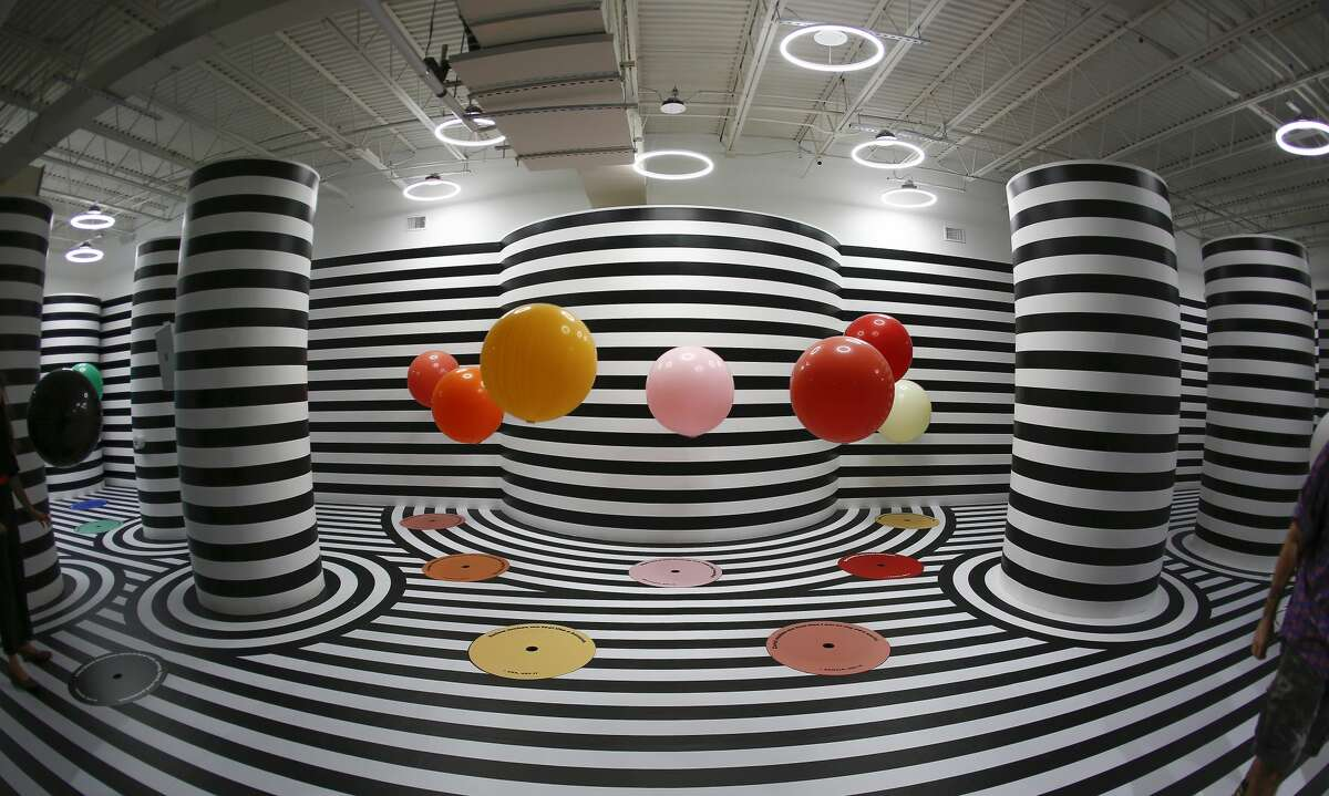 The Color Factory Houston is a 20,000-square-foot exhibit featuring 14 different interactive installations showcasing hues from a Houston-specific color palette.