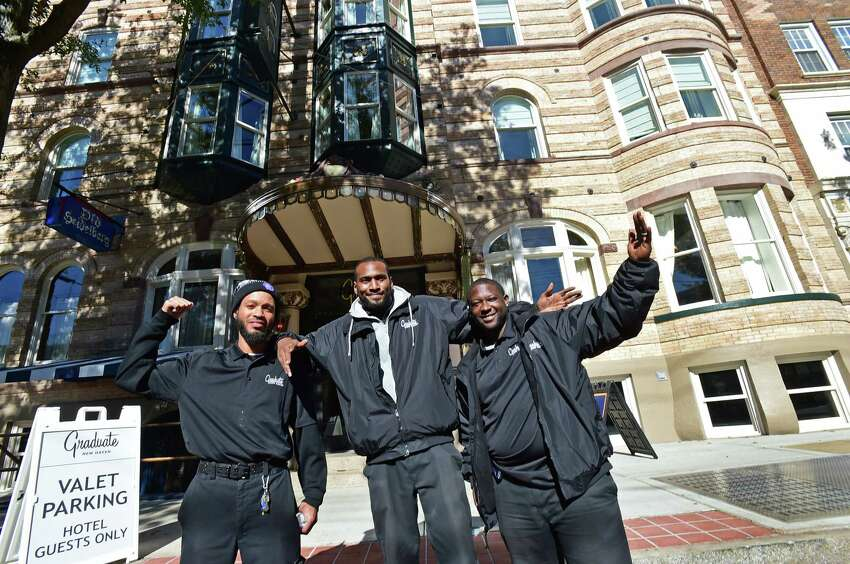 New Haven, Connecticut - Thursday, October 24, 2019: The Graduate Hotel valet parking team of Lenard Warren, Brandon Lewis, and James Jenkins, left to right, at the boutique Graduate Hotel, formally the Duncan Hotel, on Chapel Street in New Haven which had its grand opening Thursday.