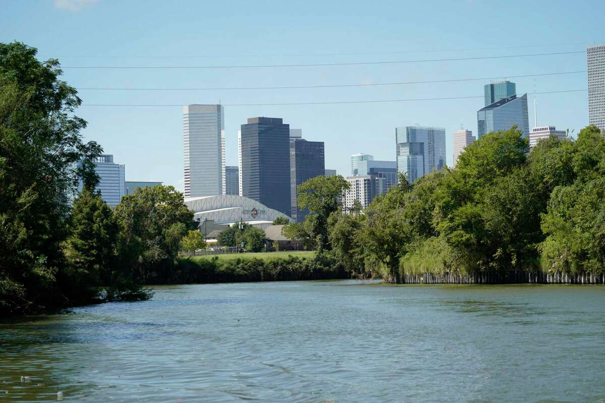Minute Maid Park and the skyscrapers of downtown create a panoramic view from the east end of Buffalo Bayou, where the water widens into a river.