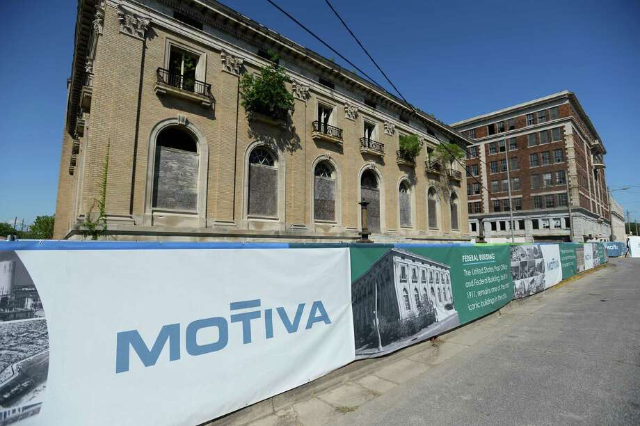 """Fencing stands around the Federal Building during Motiva and The Greater Port Arthur Chamber of Commerce's """"Imagine Port Arthur"""" in downtown Port Arthur Thursday. Motiva unveiled their plans to renovate two historic buildings at the event. Photo taken on Thursday, 05/16/19. Ryan Welch/The Enterprise Photo: Ryan Welch, Beuamont Enterprise / The Enterprise / © 2019 Beaumont Enterprise"""