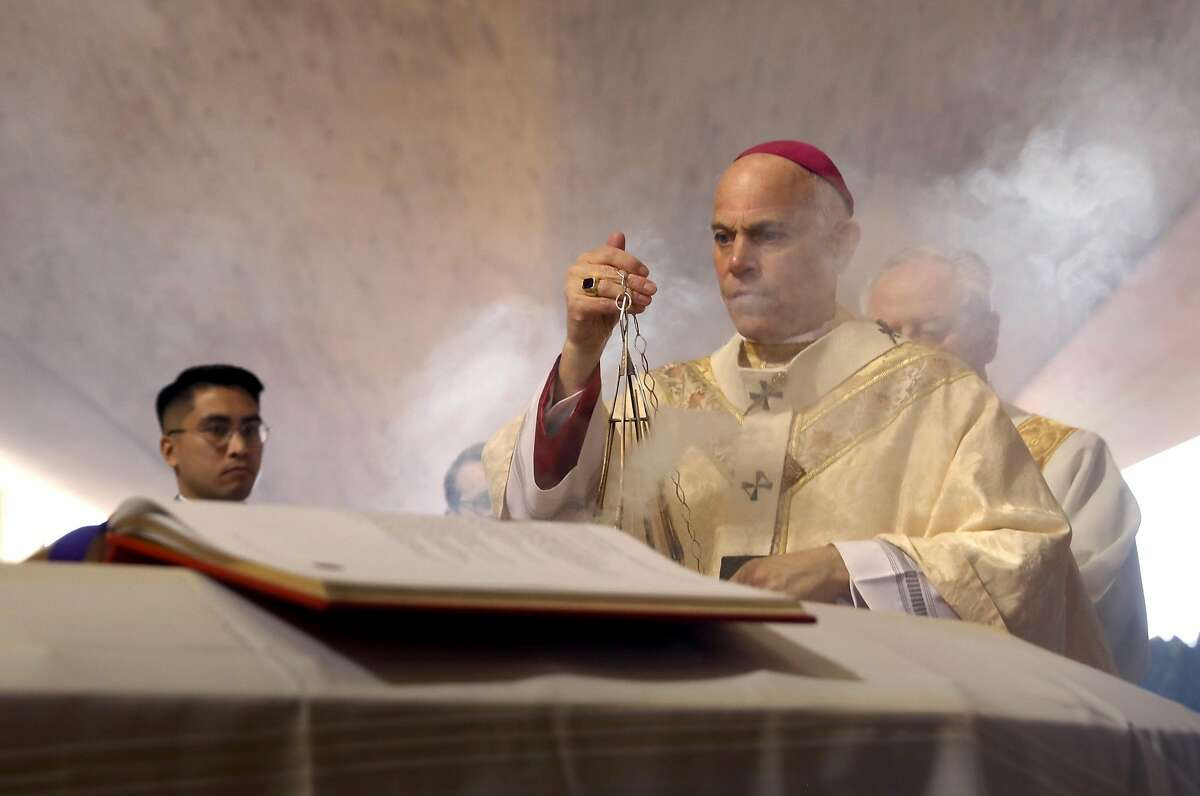 Archbishop of San Francisco, the Most Reverend Salvatore J. Cordileone leads the prayer of commendation during the funeral Mass of archbishop emeritus and Cardinal William Joseph Cardinal Levada at the Cathedral of Saint Mary on Thursday, Oct. 24, 2019, in San Francisco, Calif.