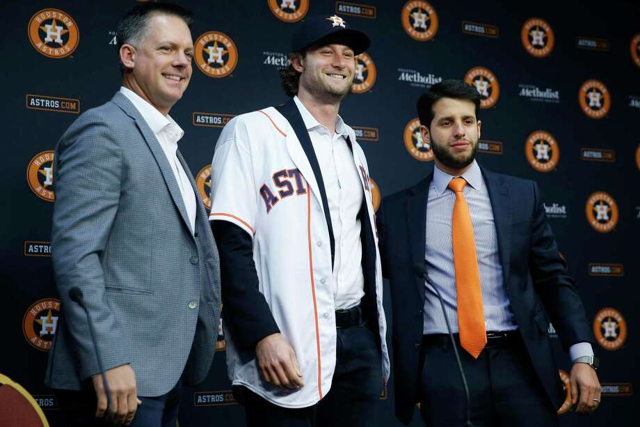 Houston Astros manager AJ Hinch, left, and Senior Director of Baseball Operations Brandon Taubman, right, introduce pitcher Gerrit Cole, who was acquired in a trade with the Pittsburgh Pirates, Wednesday, Jan. 17, 2018 in Houston. ( Michael Ciaglo / Houston Chronicle) Photo: Michael Ciaglo, Staff Photographer / Houston Chronicle / Michael Ciaglo