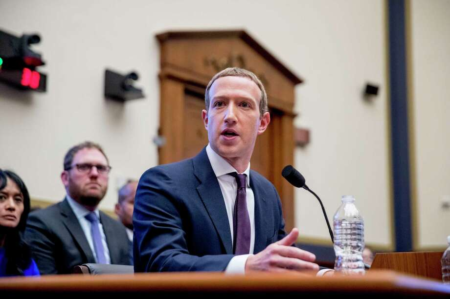 Facebook CEO Mark Zuckerberg testifies before a House Financial Services Committee hearing on Capitol Hill in Washington, Wednesday, Oct. 23, 2019, on Facebook's impact on the financial services and housing sectors. (AP Photo/Andrew Harnik) Photo: Andrew Harnik, STF / Associated Press / Copyright 2019 The Associated Press. All rights reserved