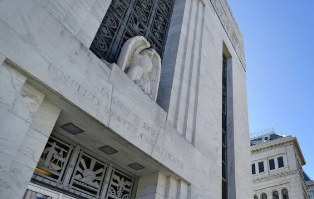 A federal judge sentenced a reputed Albany gang member Wednesday to more than four years in prison for possessing a loaded 9 mm semiautomatic pistol in his Menands apartment.