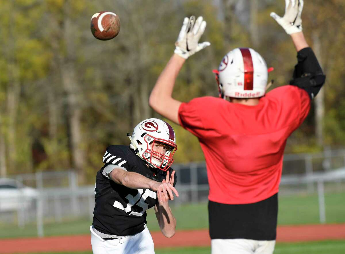 Guilderland varsity quarterback Michael Gitto throws while being pressured while running offensive plays with teammates during football practice Wednesday, Oct. 23, 2019, in Guilderland N.Y. Gitto who broke his leg missed the first five games of the season. (Hans Pennink / Special to the Times Union)