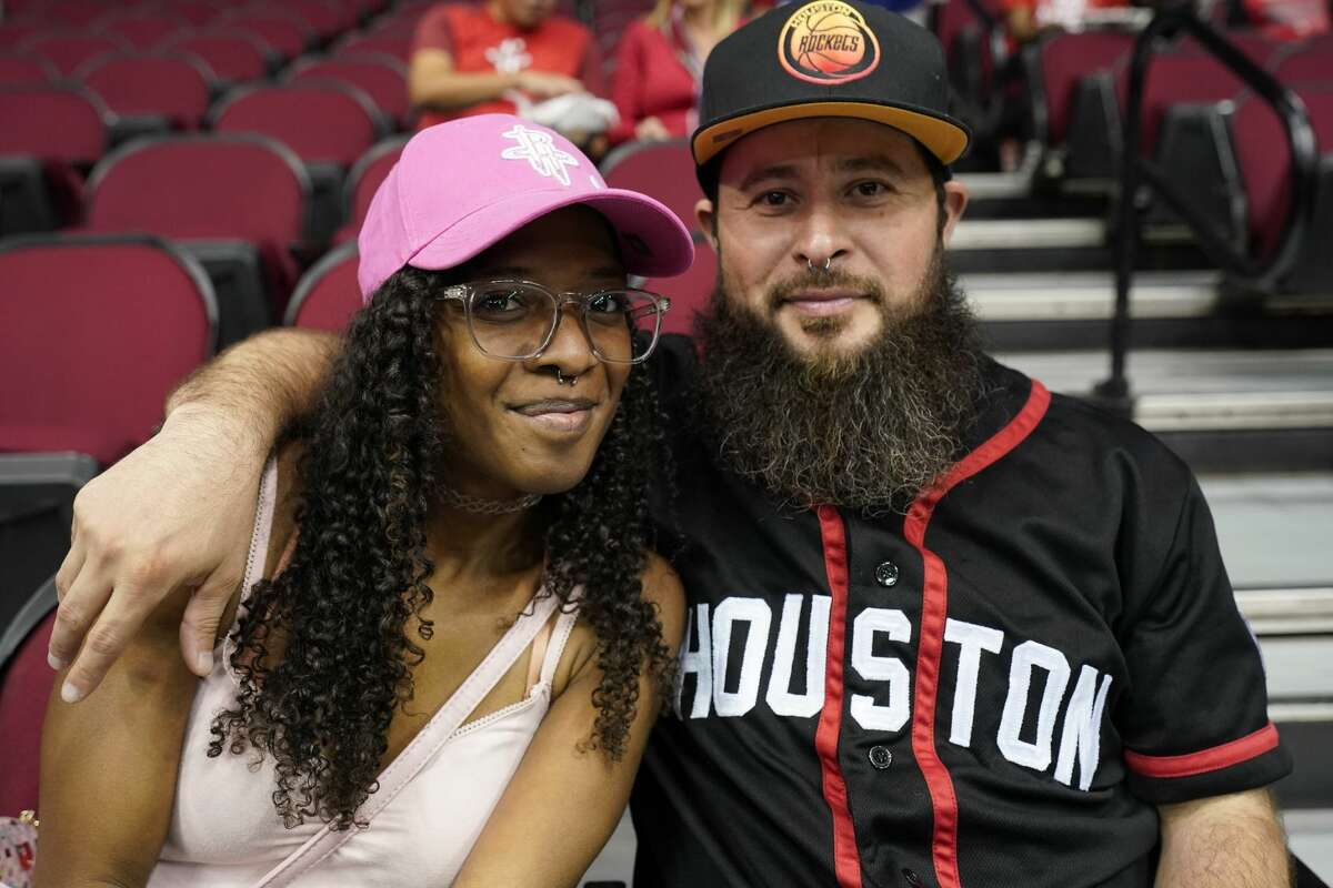 People attend the Houston Rockets NBA game against the Milwaukee Bucks Wednesday, October 24, 2019, in Houston