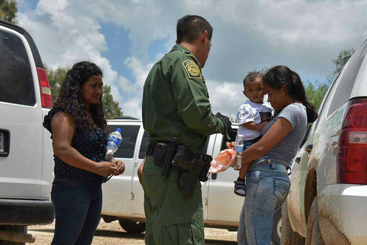Two mothers from Honduras and their children are detained by the United States Border Patrol in Granjeno, Texas, after rafting across the Rio Grande on the U.S.-Mexico border in 2018.