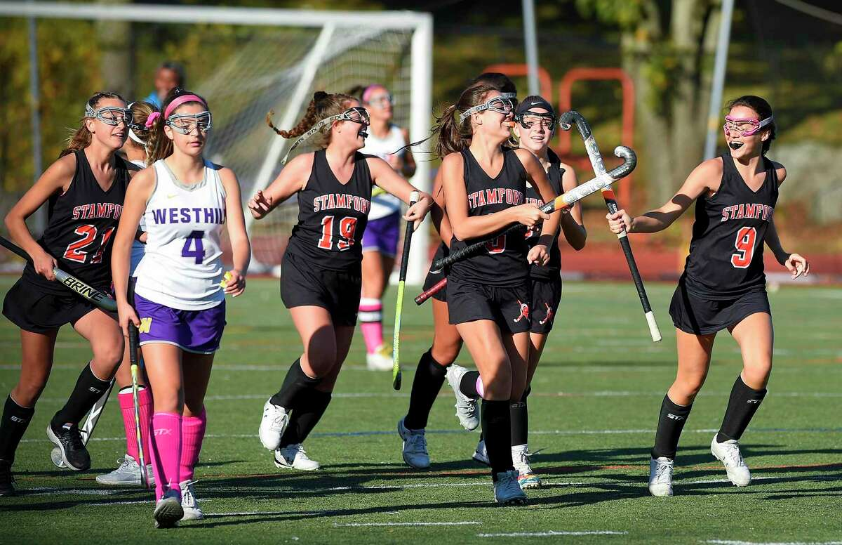 Stamford's Devon Yaghmaie (3) slaps sticks with her sister Taylor Yaghmaie (9) following her goal in the first half of a girls field hockey match against Westhill at J. Walter Kennedy Stadium in Stamford on Oct. 24, 2019.