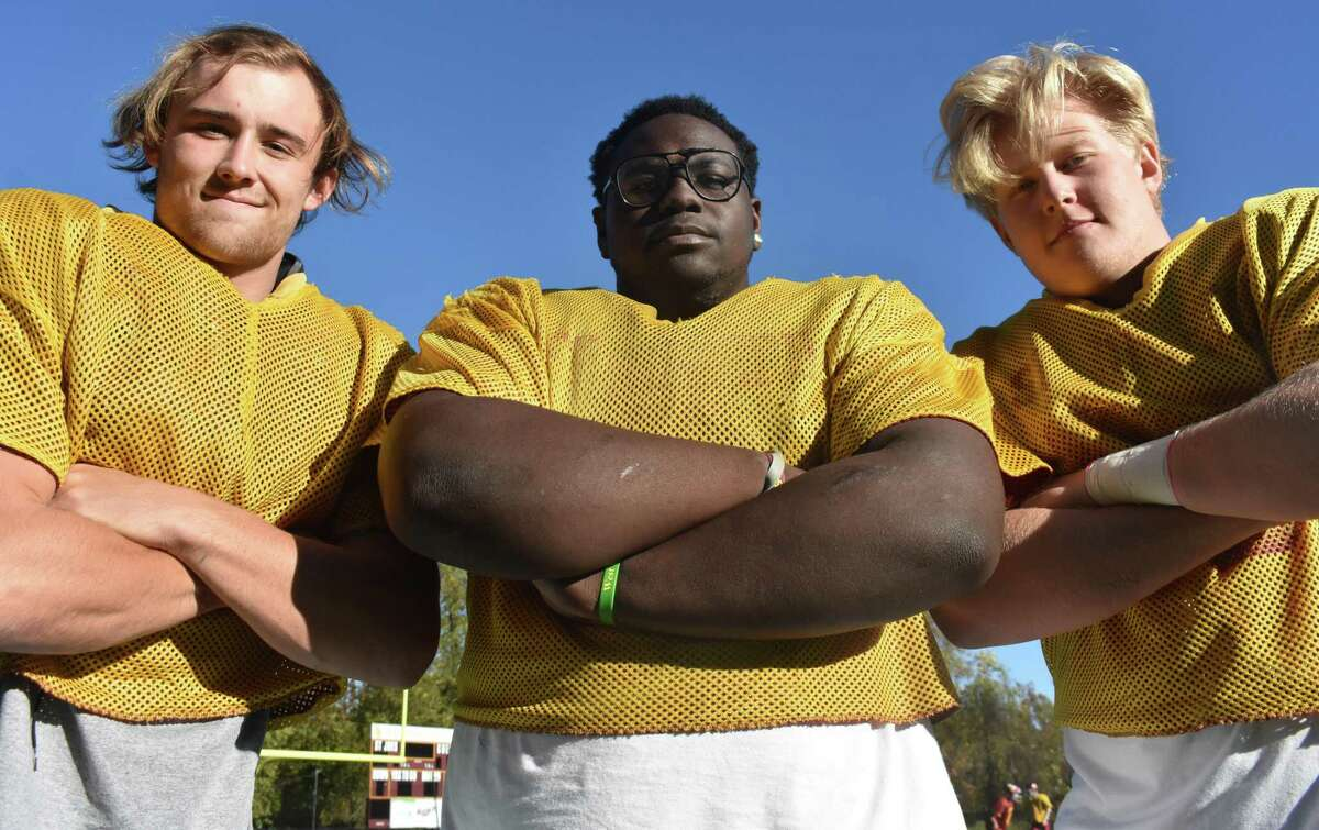 St. Joseph football's defensive line of Mike Morrissey, Jermaine Williams and Cayden Porter are anchoring the Hogs defense that has allowed just 9.6 points per game this season. (Pete Paguaga, Hearst Connecticut Media)