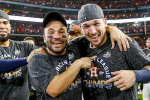 Houston Astros catcher Robinson Chirinos (28), Houston Astros second baseman Jose Altuve (27) and Houston Astros third baseman Alex Bregman (2) celebrate as the Astros win the American League Championship Series at Minute Maid Park in Houston on Saturday, Oct. 19, 2019.