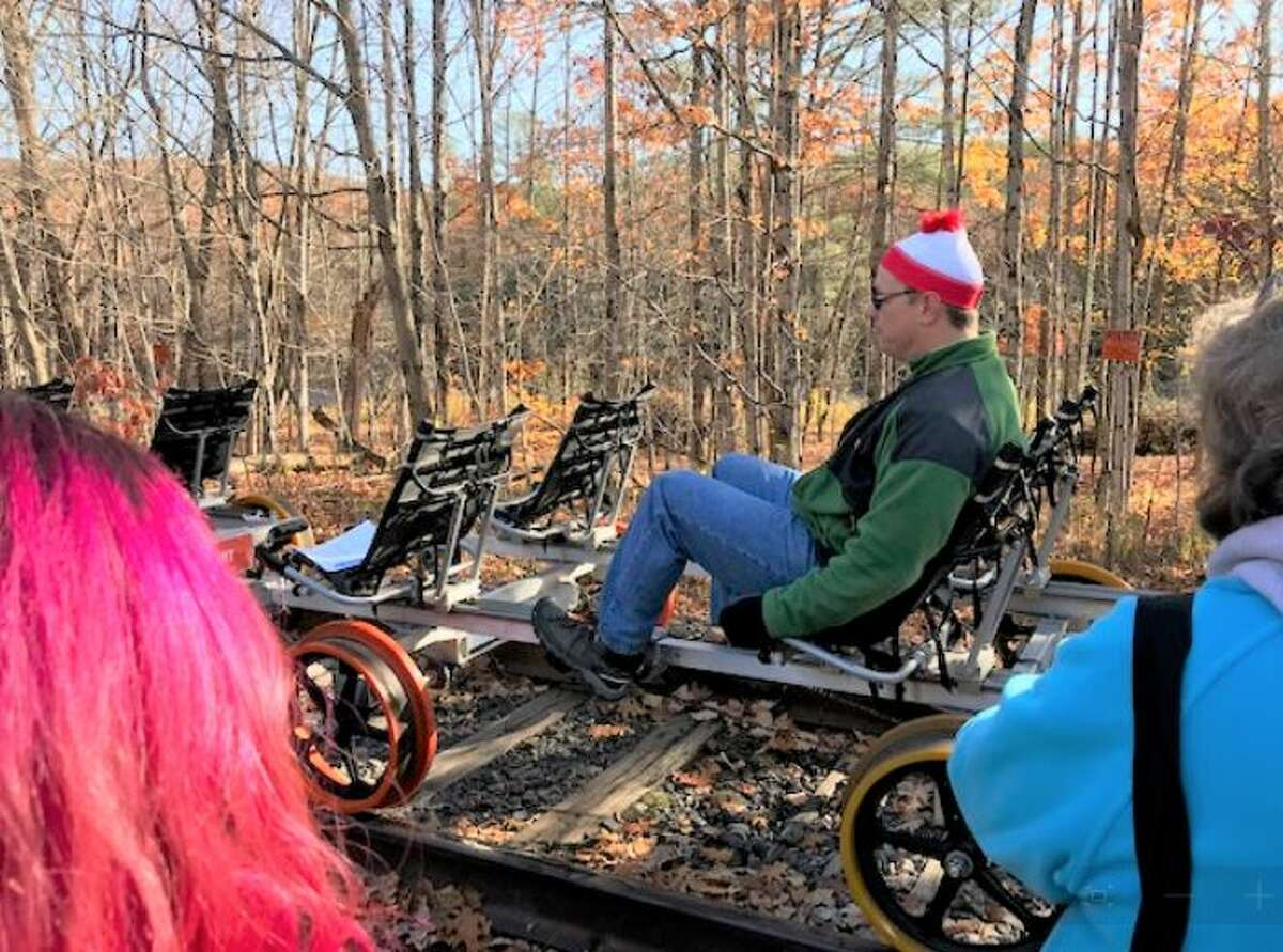 A guide with Revolution Rail demonstrates how to ride a railbike.