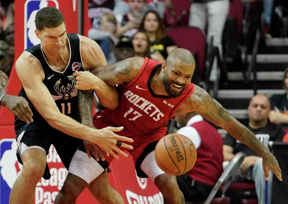 Brook Lopez of the Milwaukee Bucks tangles up with the Houston Rockets' P.J. Tucker during first half of NBA game at Toyota Center Thursday, Oct. 24, 2019, in Houston. Photo: Melissa Phillip, Houston Chronicle / Staff Photographer / © 2019 Houston Chronicle