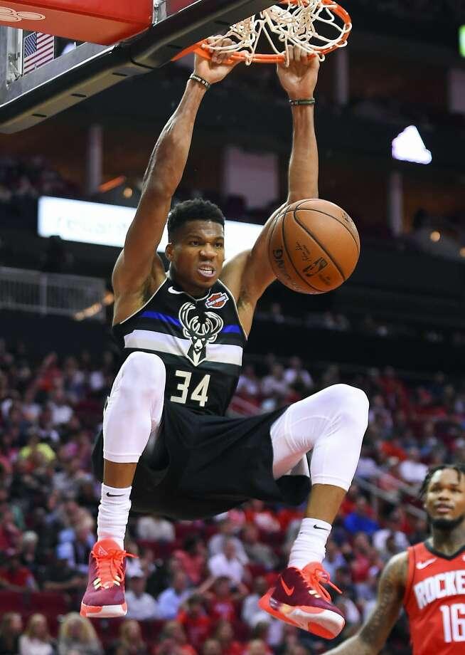 Bucks forward Giannis Antetokounmpo dunks for two of his 30 points in Milwaukee's win in Houston. Photo: Eric Christian Smith / Associated Press