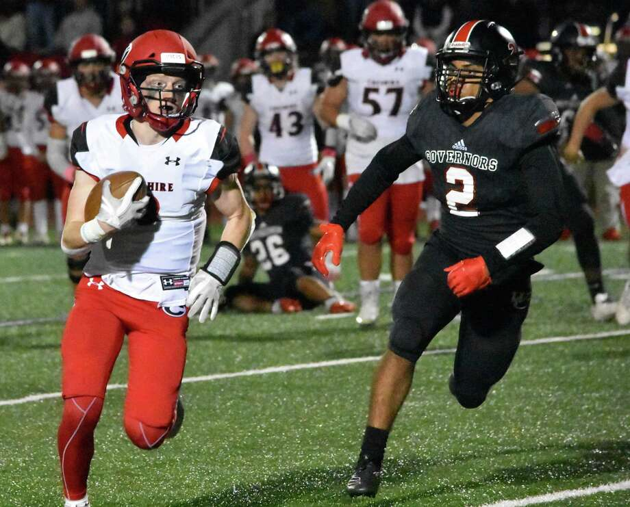 Cheshire's Colby Griffin runs up the field against Wilbur Cross at Bowen Field in New Haven on Thursday. Photo: Pete Paguaga / Hearst Connecticut Media / Connecticut Post