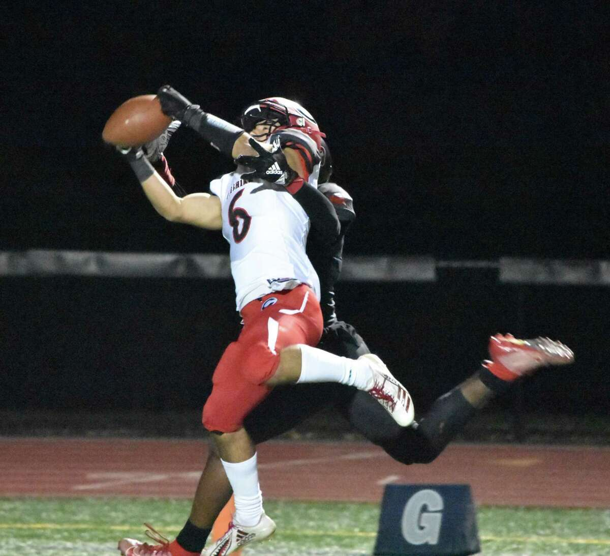 Cheshire's Christian Russo makes an interception against Wilbur Cross at Bowen Field in New Haven on Thursday.