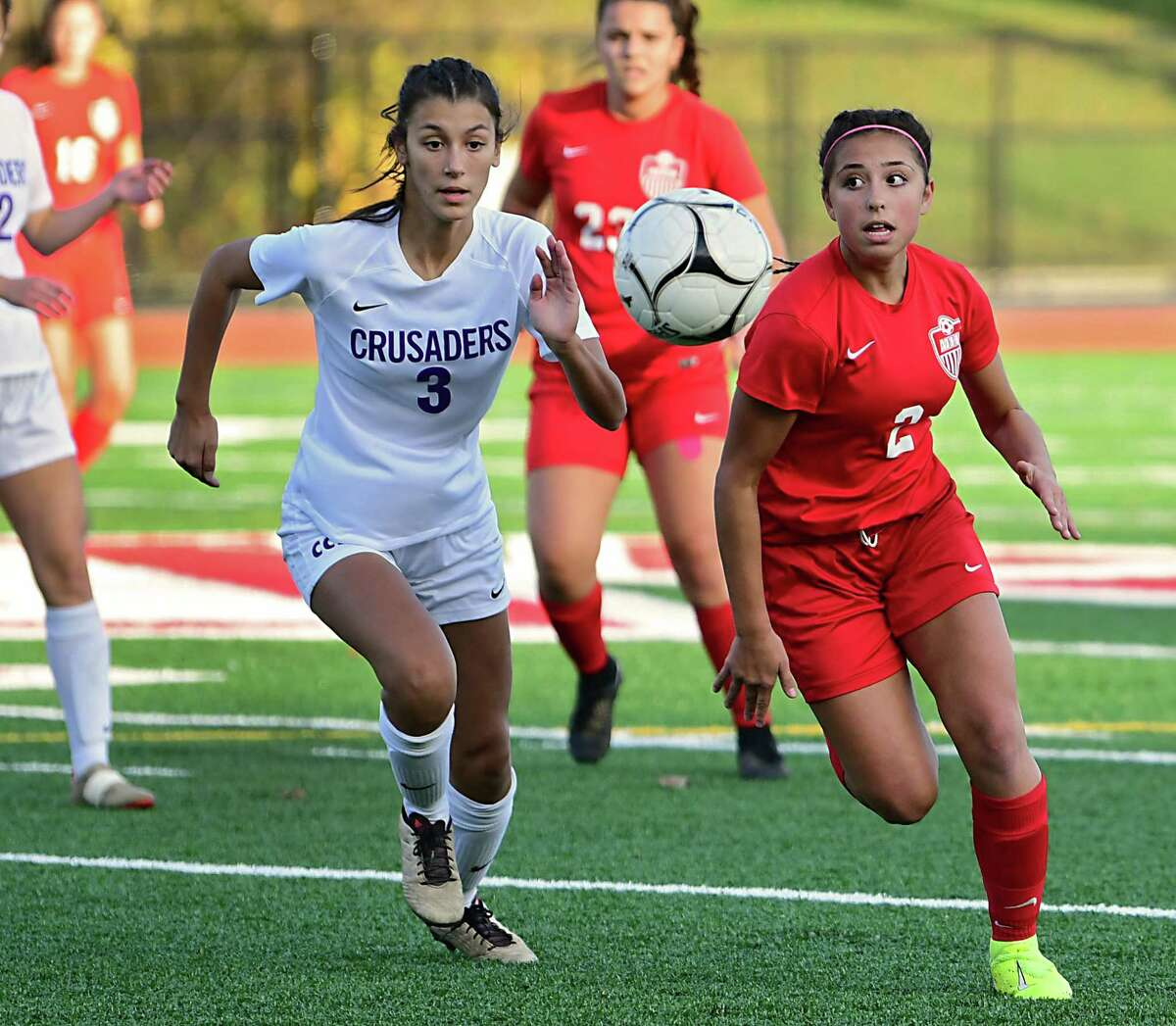 Catholic Central High School's Sam Drake, left, vies for the ball with Mechanicville's Nevaeh D'Alioa during the Class B girl's soccer playoff game on Thursday, Oct. 24, 2019 in Mechanicville, N.Y. D'Alioa scored two goals in the game. (Lori Van Buren/Times Union)