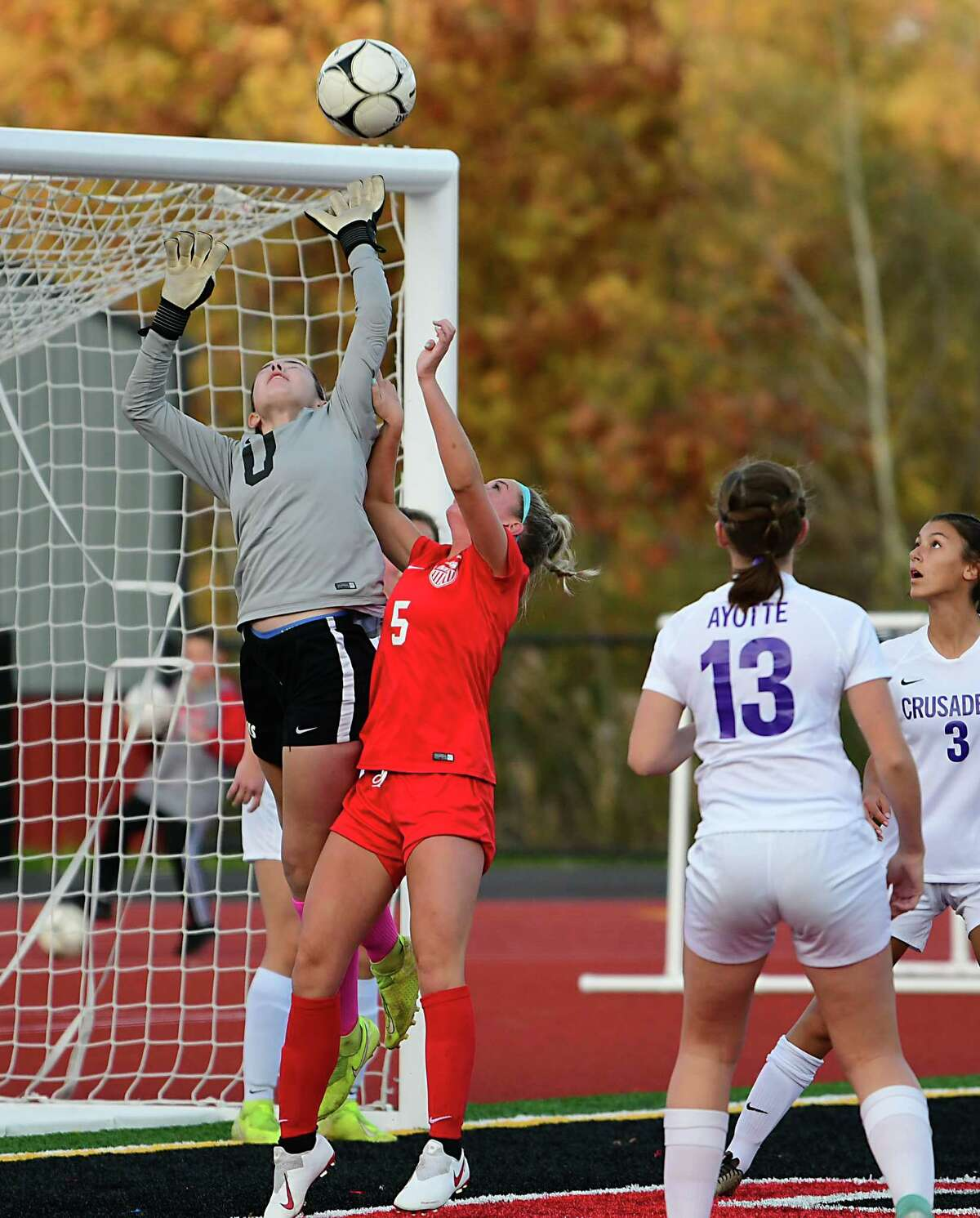 Catholic Central High School goal keeper Maddie Finn, left, makes a save after Mechanicville's Dani Rubino, #5, attempts a goal during the Class B girl's soccer playoff game on Thursday, Oct. 24, 2019 in Mechanicville, N.Y. (Lori Van Buren/Times Union)