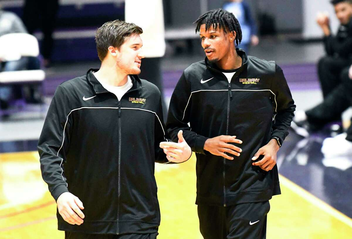 University at Albany's Brent Hank, left, and Romani Hansen during Basketball media day at the SEFCU Arena Thursday, Oct. 24, 2019, in Albany, N.Y. (Hans Pennink / Special to the Times Union)