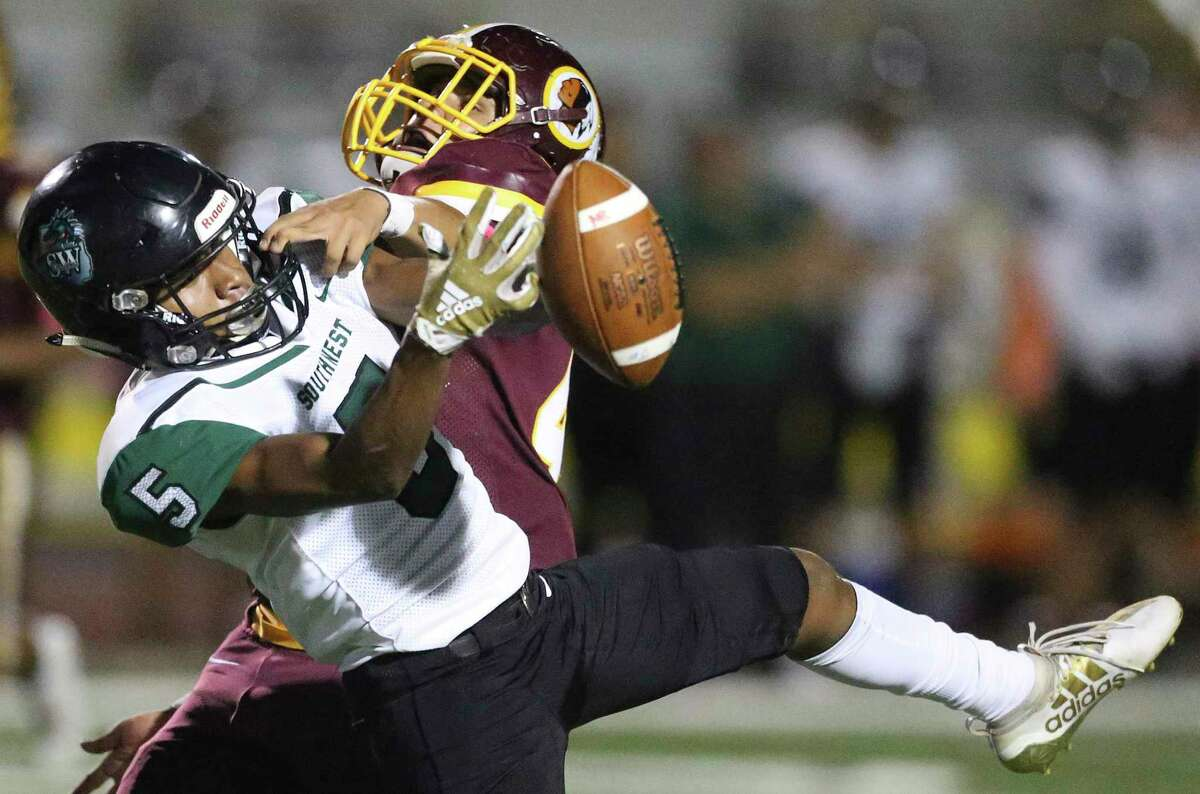 Dragons receiver Andre Mitchell is prevented from catching the ball by Xavier Garcia as Harlandale hosts Southwest at Harlandale Stadium on 24, 2019.