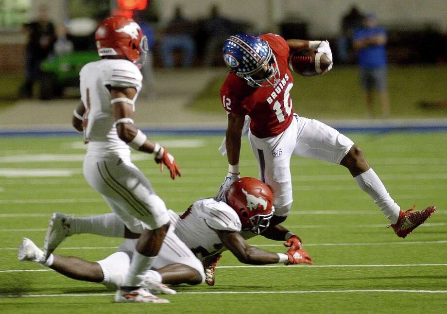 West Brook's Thaddeaus Johnson looks to evade North Shore's tackle during their match-up at BISD Memorial Stadium Thursday.  Photo taken Thursday, October 24, 2019 Kim Brent/The Enterprise Photo: Kim Brent / The Enterprise / BEN