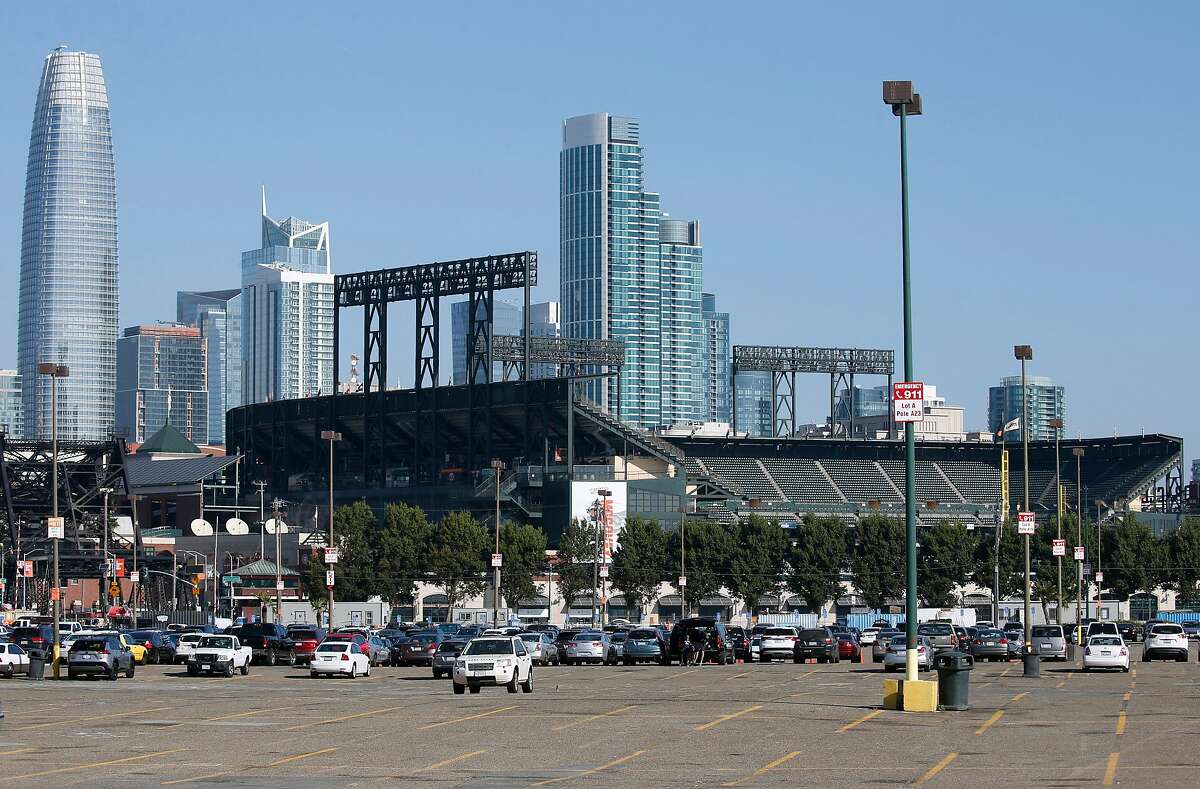 Oracle Park and the city skyline rises behind Lot A in San Francisco, Calif. on Thursday, Sept. 26, 2019. The Giants will begin development soon of a mixed use community on the site.