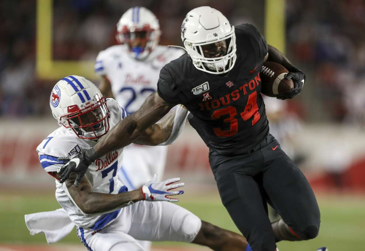 Houston Cougars running back Mulbah Car gets past Southern Methodist Mustangs cornerback Robert Hayes Jr. before being brought down at the 1-yard line during the second quarter of an NCAA football game at TDECU Stadium on Thursday, Oct. 24, 2019, in Houston.