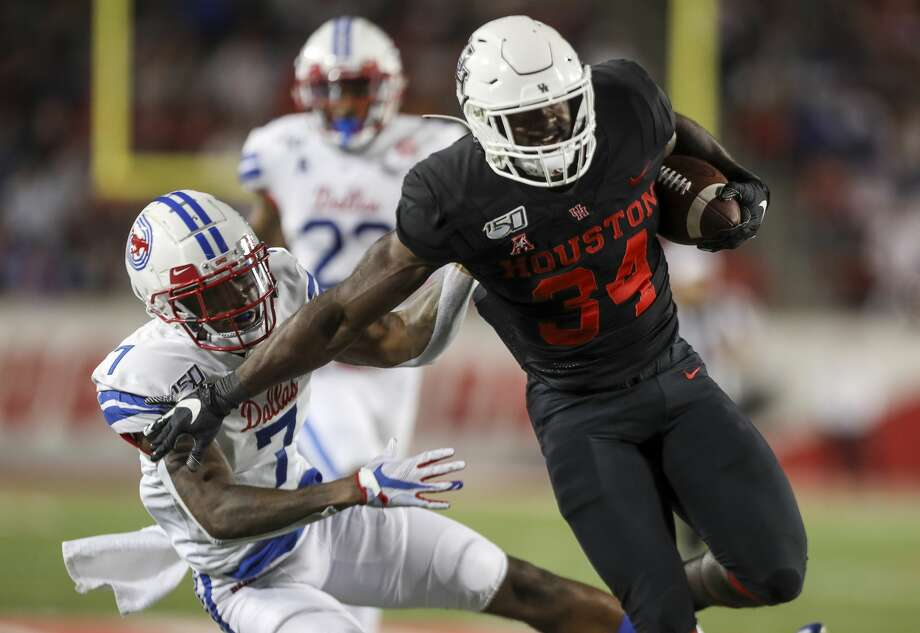 Houston Cougars running back Mulbah Car gets past Southern Methodist Mustangs cornerback Robert Hayes Jr. before being brought down at the 1-yard line during the second quarter of an NCAA football game at TDECU Stadium on Thursday, Oct. 24, 2019, in Houston. Photo: Jon Shapley/Staff Photographer