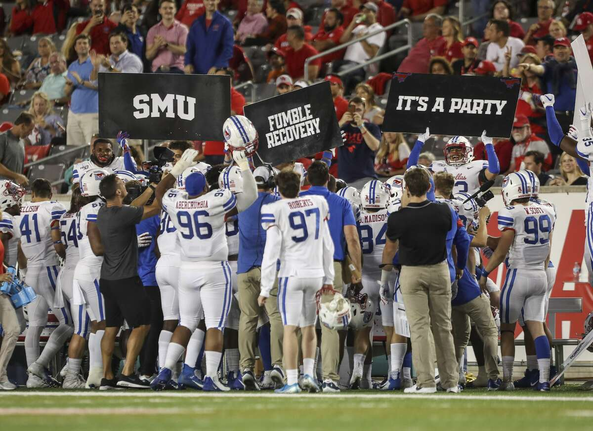 The SMU Mustangs celebrate after a fumble recovery which led to a touchdown during their 34-31 win over Houston to stay undefeated.