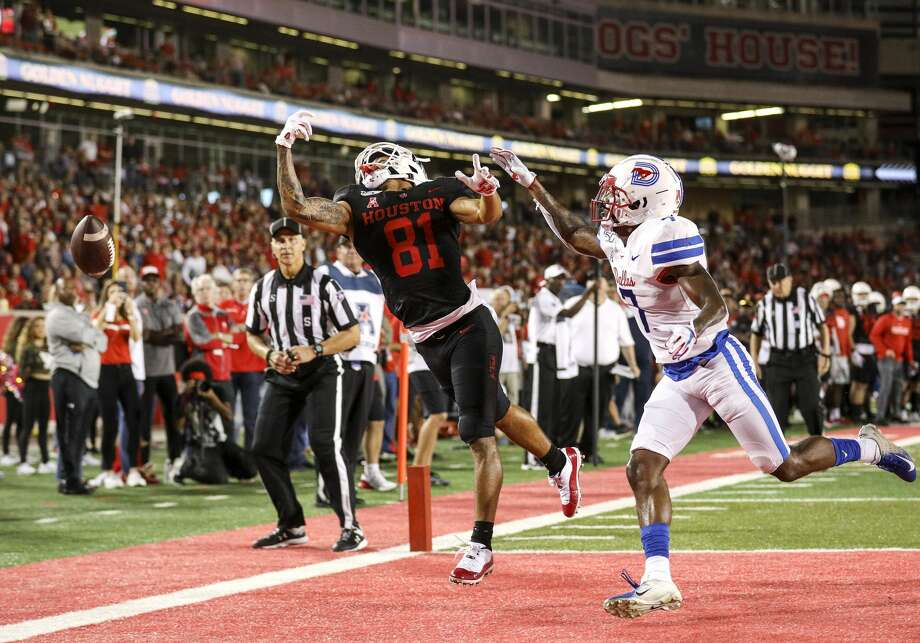 Houston Cougars wide receiver Tre'von Bradley (81) misses a pass while being covered by Southern Methodist Mustangs cornerback Robert Hayes Jr. (7) during the second quarter of an NCAA football game at TDECU Stadium on Thursday, Oct. 24, 2019, in Houston. Photo: Jon Shapley/Staff Photographer