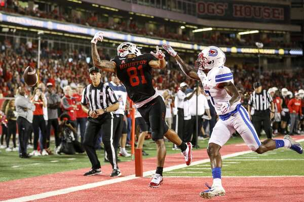 Houston Cougars wide receiver Tre'von Bradley (81) misses a pass while being covered by Southern Methodist Mustangs cornerback Robert Hayes Jr. (7) during the second quarter of an NCAA football game at TDECU Stadium on Thursday, Oct. 24, 2019, in Houston.