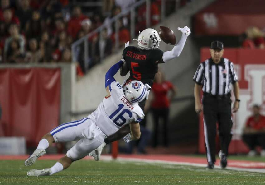 Houston Cougars wide receiver Marquez Stevenson (5) misses a pass while being covered by Southern Methodist Mustangs safety Trevor Denbow (16) during the first quarter of an NCAA football game at TDECU Stadium on Thursday, Oct. 24, 2019, in Houston.