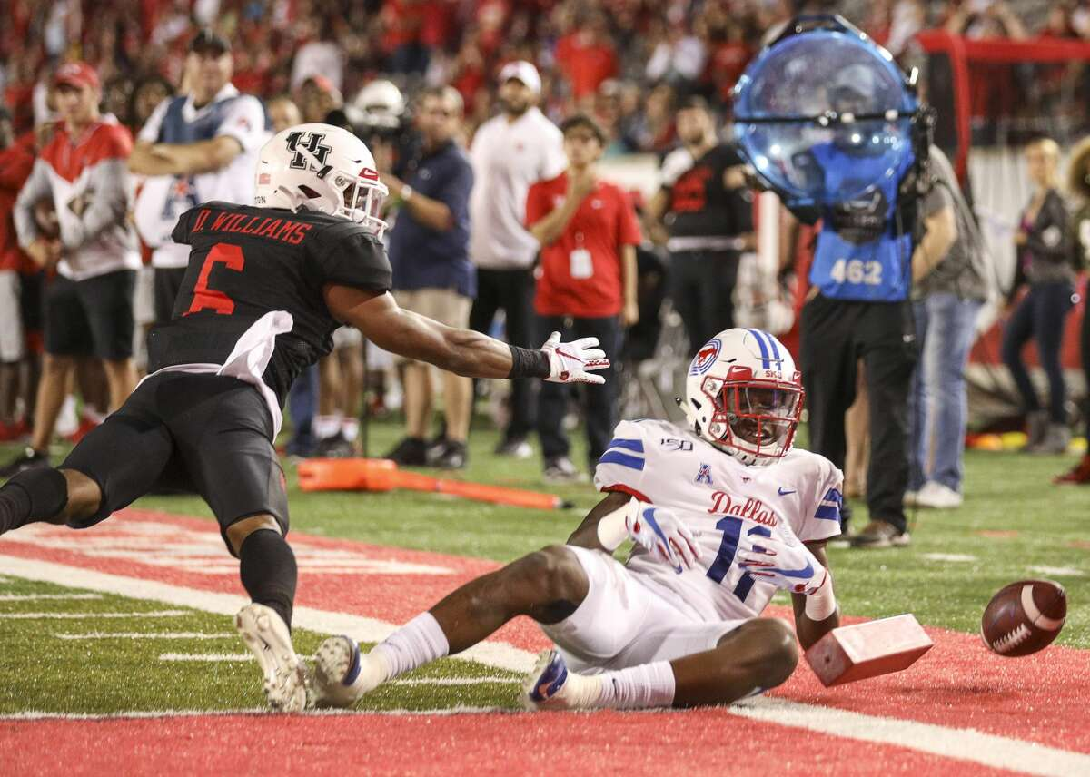 Houston Cougars cornerback Damarion Williams (6) breaks up a pass intended for Southern Methodist Mustangs wide receiver Rashee Rice (11) during the third quarter of an NCAA football game at TDECU Stadium on Thursday, Oct. 24, 2019, in Houston.