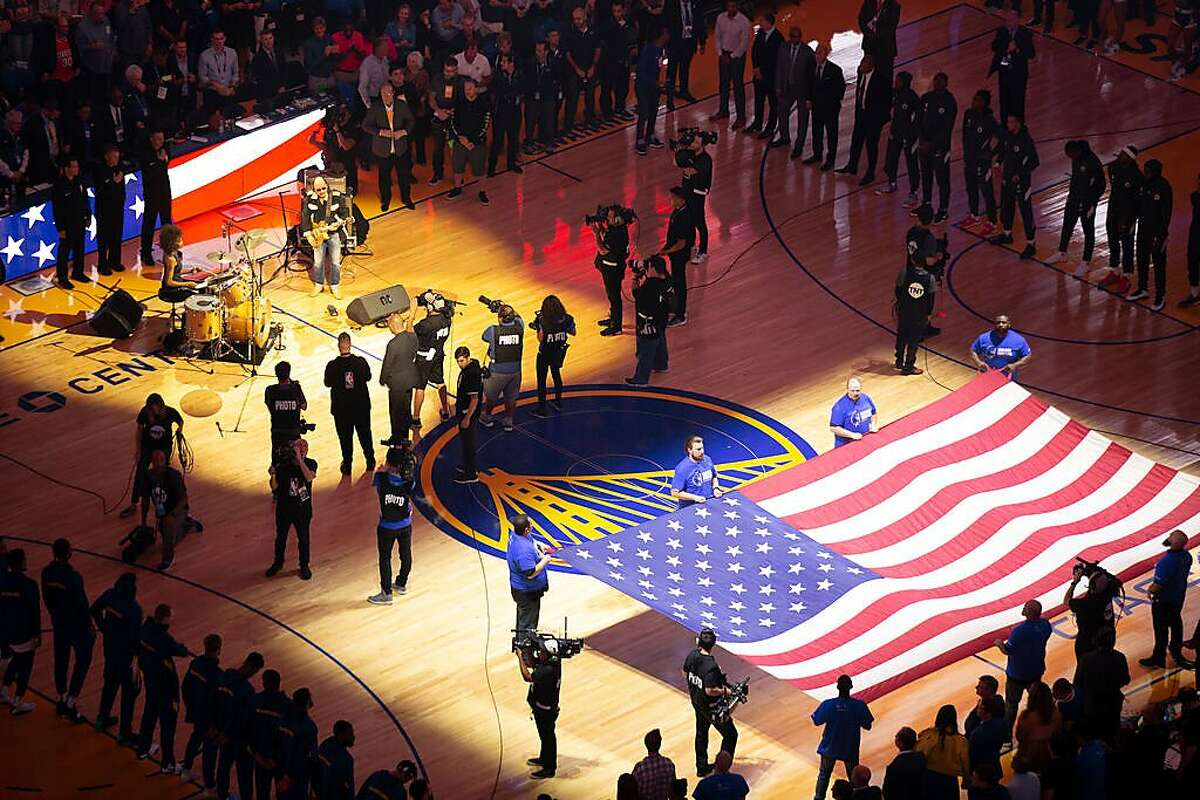 Carlos Santana plays the national anthem before the Golden State Warriors' inaugural regular season NBA basketball game at the new Chase Center on Thursday, Oct. 24, 2019 in San Francisco, Calif.