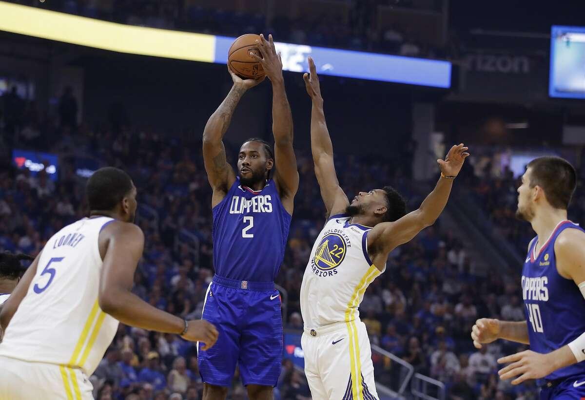 Los Angeles Clippers' Kawhi Leonard (2) shoots next to Golden State Warriors' Glenn Robinson III (22) during the first half of an NBA basketball game Thursday, Oct. 24, 2019, in San Francisco. (AP Photo/Ben Margot)