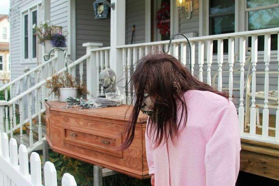 A ghoulish display is set up at 701 Kosciusko St. in Manistee, haunting the neighborhood in Maxwelltown. (Ashlyn Korienek/News Advocate)