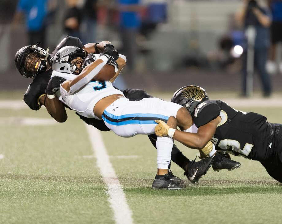 PHOTOS: Shadow Creek vs. Foster Kelvon Brown (3) of the Shadow Creek Sharks is stoped for a 4 yard loss by Udoka Ezeani (52) and Zachary Hopper (23) of the Foster Falcons in the first half in a high school football game on Thursday, October 24, 2019 at Traylor Stadium in Rosenberg Texas. Photo: Wilf Thorne/Contributor