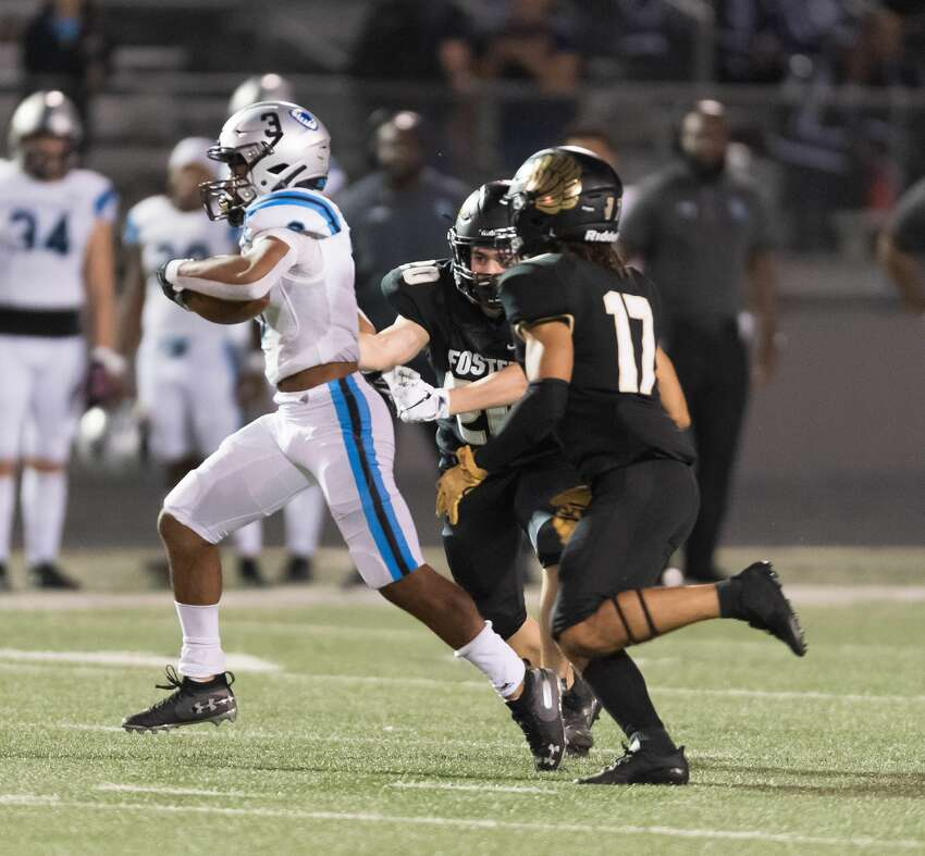 Kelvon Brown (3) of the Shadow Creek Sharks breaks from the grip of Ethan Kappes (20) of the Foster Falcons for a long run in the second half in a high school football game on Thursday, October 24, 2019 at Traylor Stadium in Rosenberg Texas.
