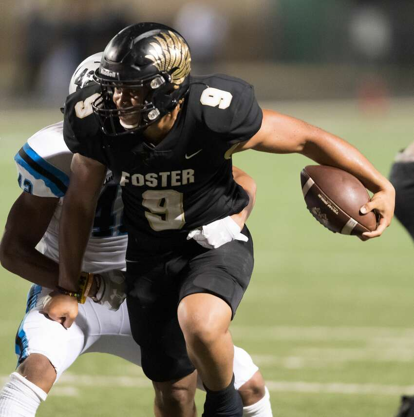 Issac Johnson (9) of the Foster Falcons runs for a short gain in the second half against the Shadow Creek Sharks in a high school football game on Thursday, October 24, 2019 at Traylor Stadium in Rosenberg Texas.