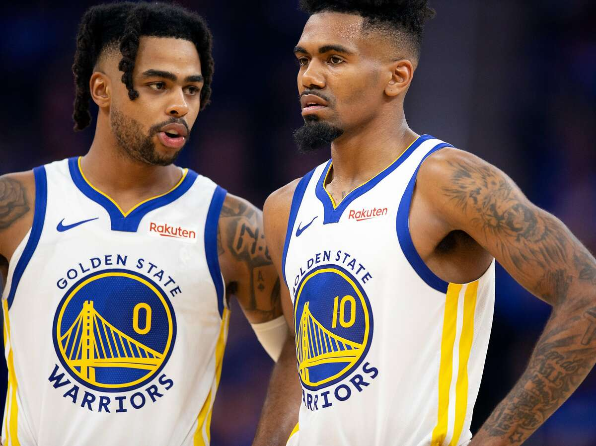 Golden State Warriors guard D'Angelo Russell (0) and guard Jacob Evans (10) commiserate during a timeout in the fourth quarter of an NBA basketball game at the new Chase Center on Thursday, Oct. 24, 2019 in San Francisco, Calif. The Clippers defeated the Warriors 141-122.