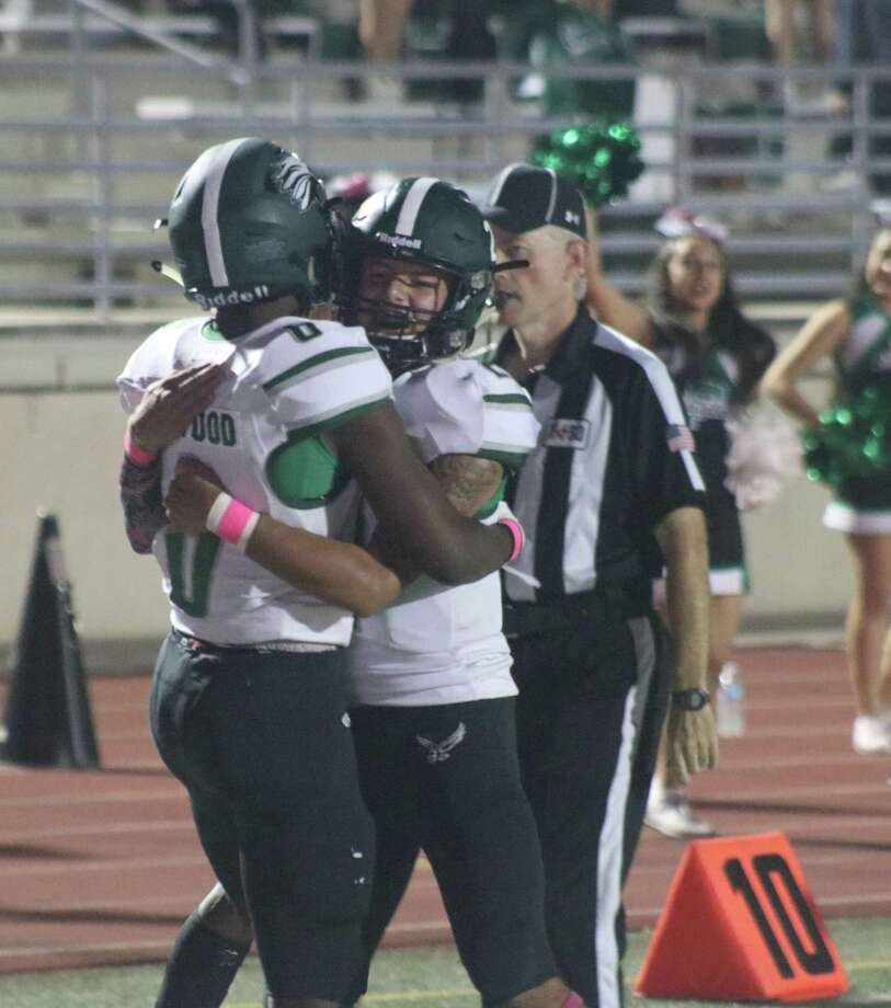 Pasadena's Kemon Haywood receives a congratulations embrace from quarterback Joshua Spann after the two hooked up for a 15-yard scoring toss in the second quarter Thursday night. Photo: Robert Avery