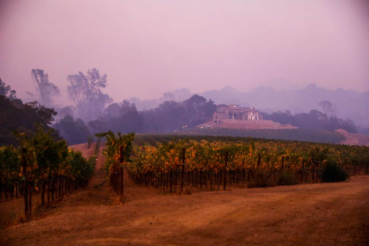 Smoke from the Kincade Fire is seen in the hills in Geyserville, California, on Thursday, Oct. 24, 2019.